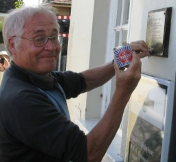 Colin polishes the plaque